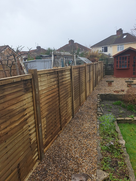 strom damaged fence repaired